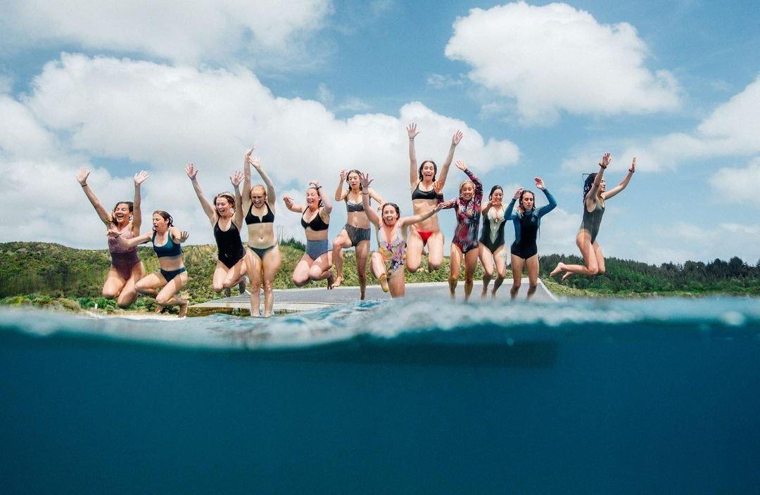 salt sisters jumping in water